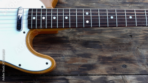 electric guitar on the wooden boards at country barn - 291476459