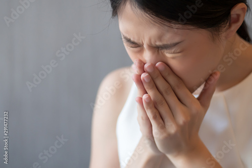 asian woman sneezing; concept of health care, body care, sickness, cold, flu, al Tablou Canvas