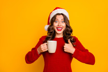 Pretty Lady Holding Hot Beverage In Hands Advising Cool Drink Wear Knitted Jumper And Santa Hat Isolated Yellow Background