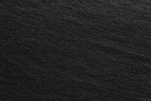 Black Sand Beach Macro Photography. Texture Of Black Volcanic Sand For Background.