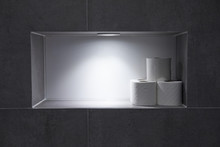 Toilet Rolls In A Recess In Th...