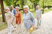 Happy Senior People Walking On The Street