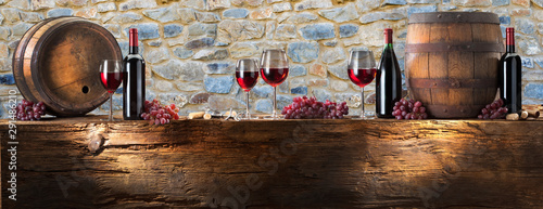 Foto auf Leinwand Wein red wine on a background of rocks on old wood