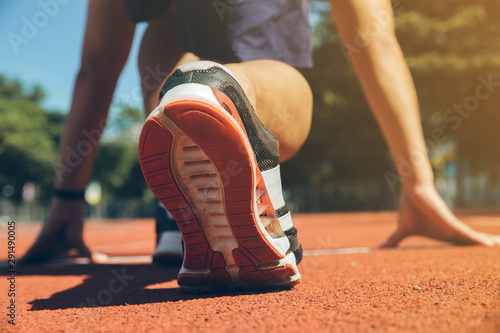 Fotografiet  Close up on running shoe of man having runner stretching before the run