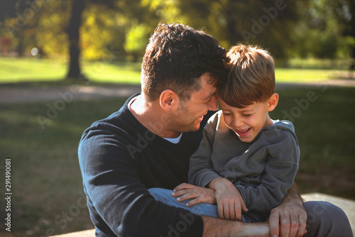 Smiling son having fun with his father Canvas Print