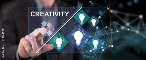 Obraz Man touching a creativity concept - fototapety do salonu