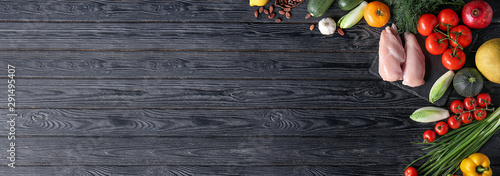 Various healthy products on wooden background