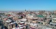 Aerial: Drone reversing on snow covered buildings in city - Irkutsk, Russia