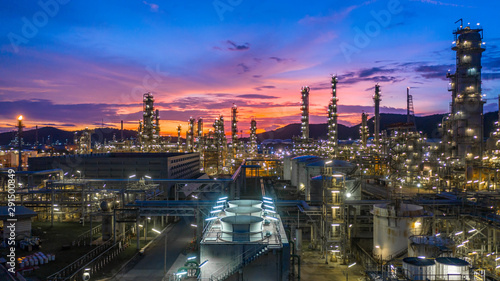 Deurstickers Planten Oil​ refinery​ with oil storage tank and petrochemical​ plant industrial background at twilight, Aerial view oil and gas refinery at twilight.