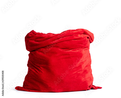 Fototapeta Santa Claus open red bag full, isolated on white background. File contains a path to isolation. obraz