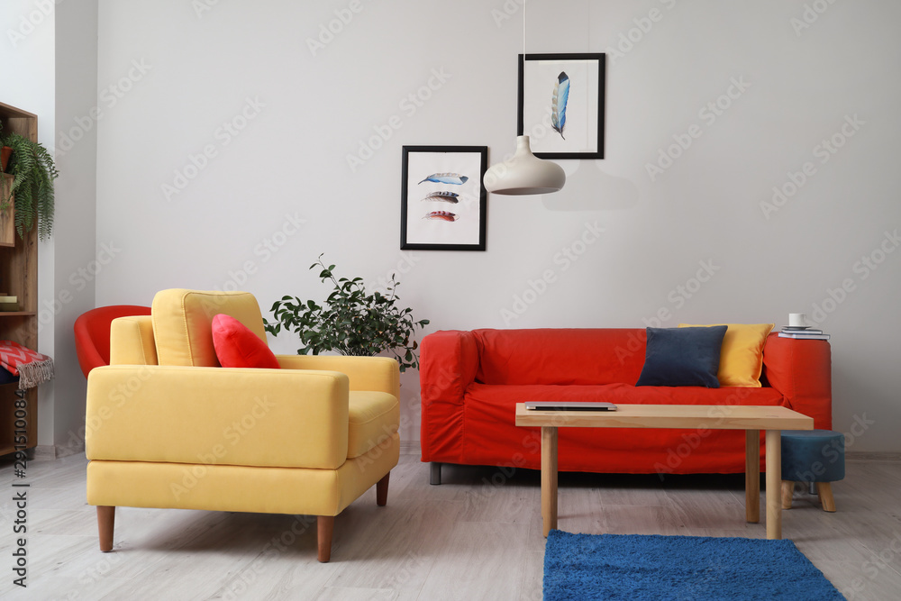 Fototapeta Stylish interior of living room with bright furniture
