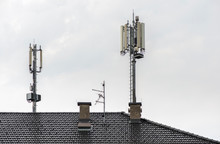 5G Antennas On Top Of House. Antennas And Transmitters On Roof.