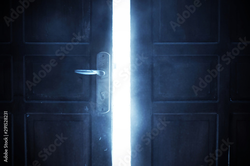 Photo Open door with bright light, halloween theme