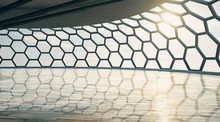 Futuristic Style Empty Hall With Honeycomb Window And Wooden Floor At Sunset.