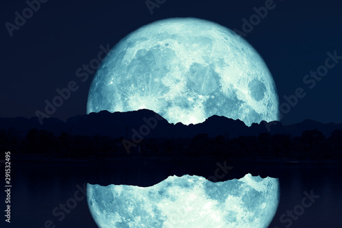 reflection of super sturgeon moon on river night red sky back silhouette mountai Canvas Print