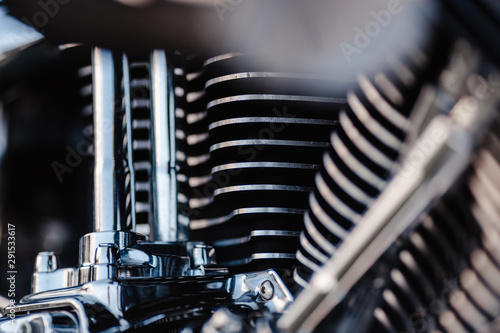 Rivne, Ukraine - September 23, 2019: Harley-Davidson Fat Boy motorcycle detail. Motorcycle engine exhaust pipes. Close up of a classic motorcycle with lots of chrome details.