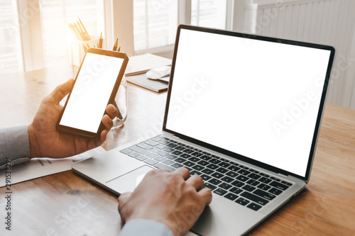 Obraz na plátně  Mockup image of close up business woman working with smartphone laptop and docum