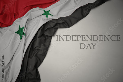 waving colorful national flag of syria on a gray background with text independence day Tablou Canvas