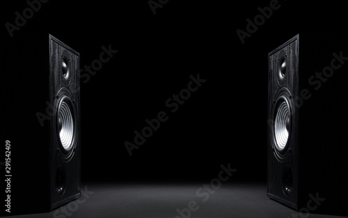Two sound speakers with free space between them on black  background. - 291542409