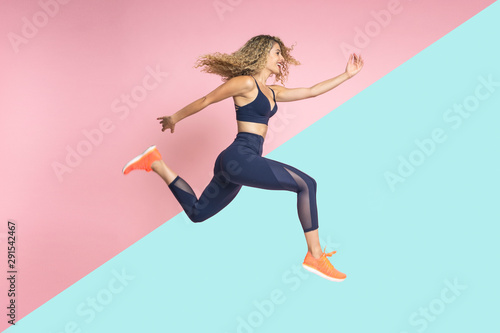 Fényképezés  woman running in movement on isolated background