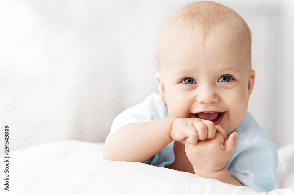 Fototapeta Portrait of a crawling baby