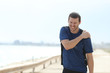 Sportsman complaining suffering shoulder ache after sport