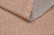 Fabric knitwear krupnomery beige. The texture of the knitted fabric