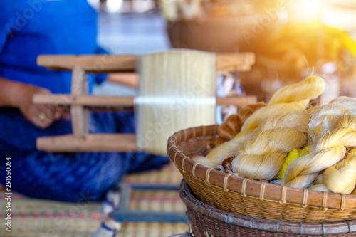 The golden thread from the silk Is a handicraft weaving work Canvas Print