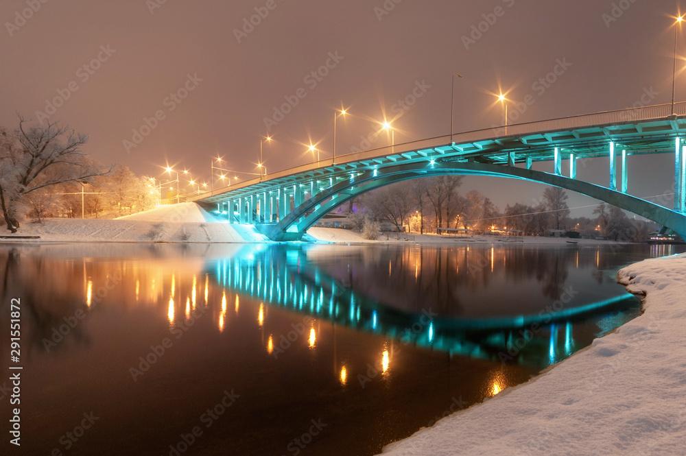 Fototapeta night city view, luminous  bridge. winter cityscape