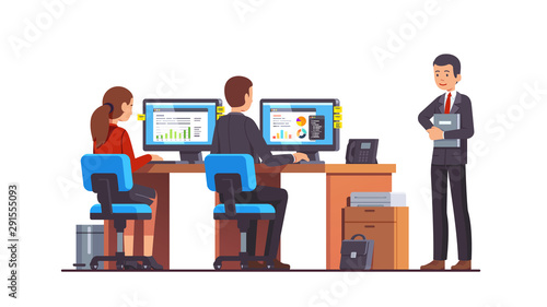 Boss watching at two analyst employees working