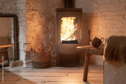 Wood stove fireplace in comfort cozy house Fototapet