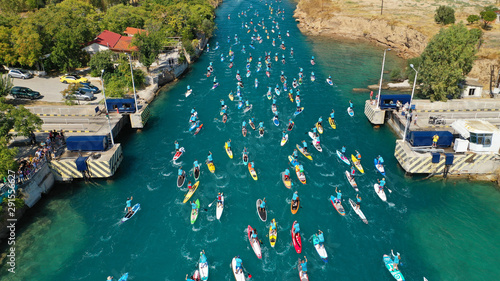Poster de jardin Europe Méditérranéenne Aerial bird's eye view photo taken by drone of stand up paddle surfers in annual SUP crossing competition in Corinth Canal, Greece