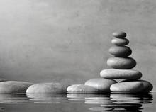 Stack Of Grey Massage Stones On Grey Background.