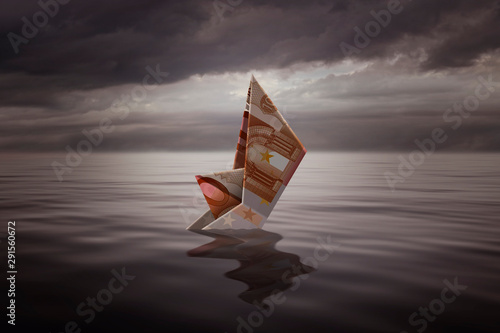 Photo sur Toile Pays d Afrique Sinking a little boat made with a euro bill