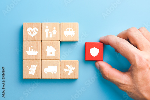 Fotografía Hand holding red wooden blocks with insurance icons