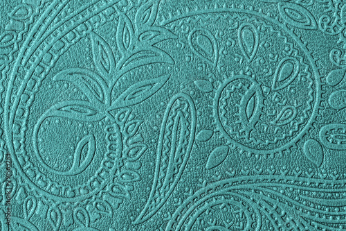 Fotografie, Obraz  Texture of genuine leather with embossed floral trend pattern close-up, green mint color, for wallpaper or banner design