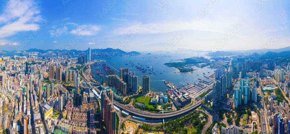 Fototapeta Aerial top view of Hong Kong Downtown, republic of china. Financial district and business centers in smart urban city in Asia. Skyscrapers and high-rise modern buildings at noon.