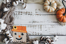 Pumpkins And Scarecrow On Whit...