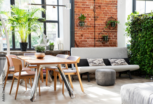 Fotografía  modern interior of living room  with a table and chairs and sofa