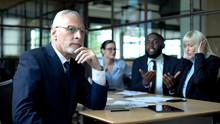 Pensive Senior Businessman Thinking, Nervous Colleagues Arguing, Stress At Work