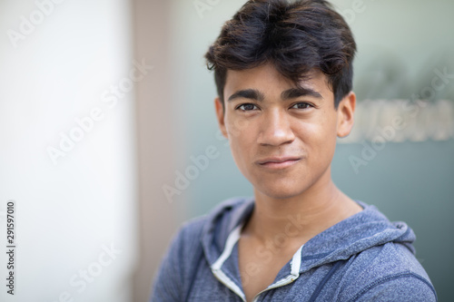 Fototapety, obrazy: Portrait of a handsome Asian young man next to the blurred background
