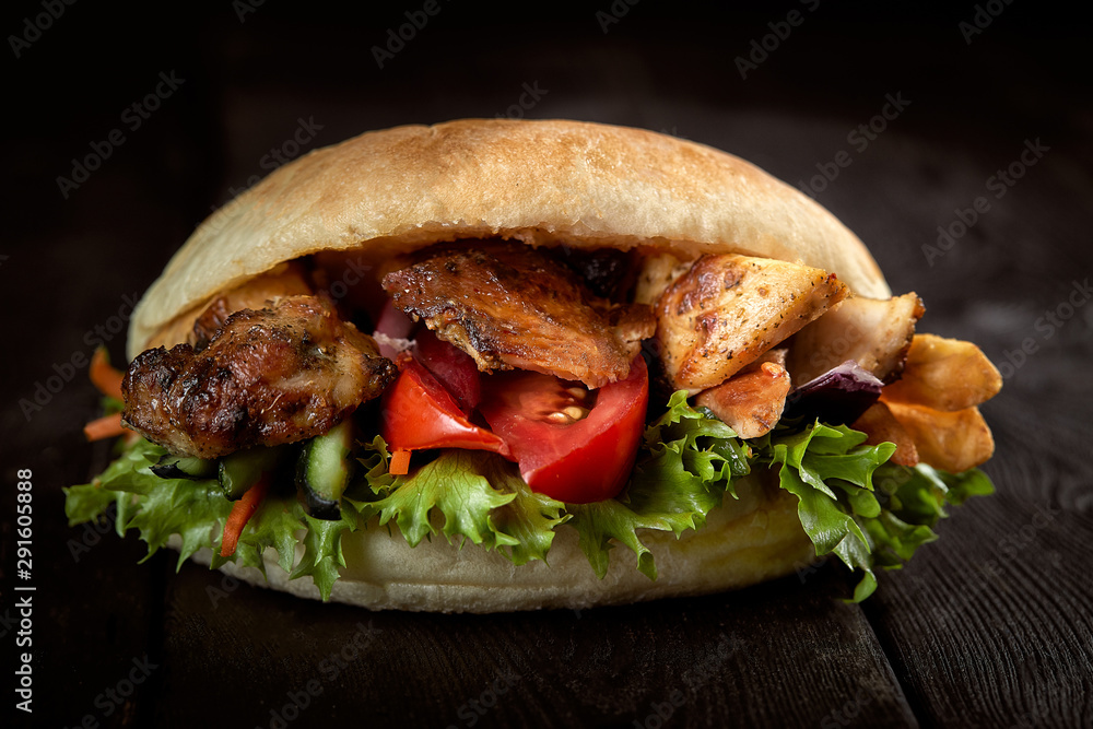 Fototapety, obrazy: close up of kebab sandwich on wooden background