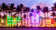 Miami Beach Ocean Drive Hotels And Restaurants At Sunset. City Skyline With Palm Trees At Night. Art Deco Nightlife On South Beach