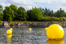 Yellow Floating Balls Buoy On A River In Gatineau Lac Leamy Lake