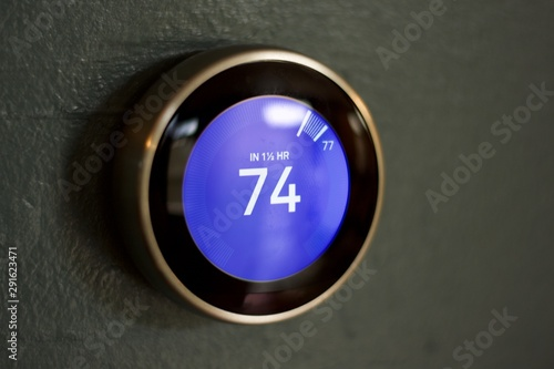 Isolated smart home thermostat on blue wall up close macro in cooling room Wallpaper Mural