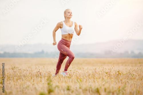 Fotografering  Hair fluttering in wind blonde girl runner dawn, concept workout
