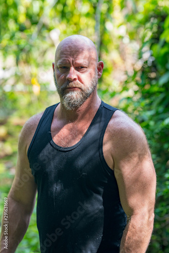 Photo sur Toile Ecole de Danse Farmer man in a black tank top posing outdoors in the garden