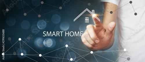 Cuadros en Lienzo businessman presses smart home icon