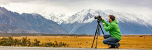 Photographer Man Taking Nature Photography With Professional SLR Camera At Mountain Landscape, New Zealand Banner. Tourist On Travel Adventure Holiday Shooting Video On Tripod Panorama.