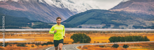 Fotografía Athlete runner running in mountain landscape in panoramic banner background